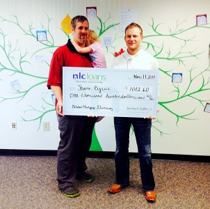 Shane Cyrus receives his award from NLC Loans CEO Jeremy Sopko.