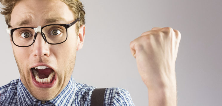 excited man holding fist up