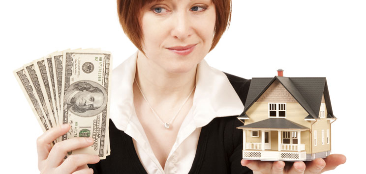 woman holding money and a house